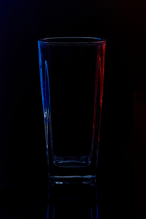 Silhouette of a glass  on a black background Banque d'images