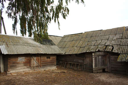 farmstead: old wooden sheds on a farmstead of the farm in the Belarusian province