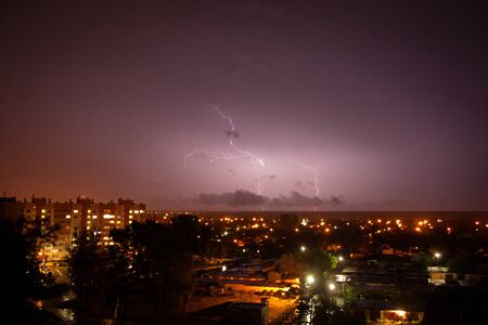 dancing lightning in the night sky over the city