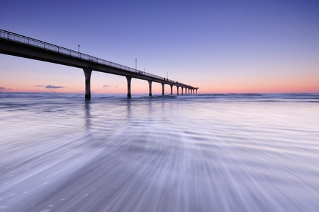 Sunset and wave flow in New Brighton Pier, Christchurch New Zealand