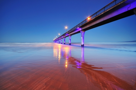pier: Long exposure of an ocean and New Brighton Pier Christchurch