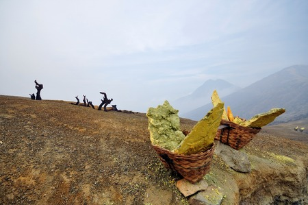 Solid sulfur chunk in a basket waiting to be carried out of the Kawah Ijen volcano, a sulfur mining operation in East Java, Indonesia   photo