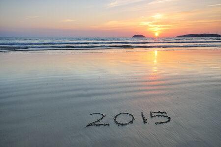 Year 2015 written on sand at Sunset  photo