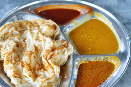 Roti canai flat bread, Indian food, made from wheat flour dough  Famous malaysian dish, Roti canai and curry
