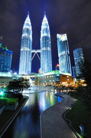vertical: KUALA LUMPUR, MALAYSIA - OCTOBER 30: Night scenery of Petronas Twin Towers on October 30, 2010 in Kuala Lumpur, Malaysia. Petronas Twin Towers is a famous landmark in Kuala Lumpur Malaysia. Editorial