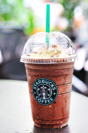 starbucks: KUALA LUMPUR, MALAYSIA - October 31, 2010: Glass of fresh Starbucks Coffee Frappuccino Blended Beverages. Starbucks is the world