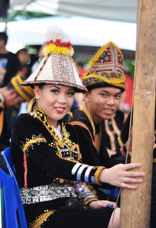 harvest festival: Kota Kinabalu, Sabah, Malaysia - MAY 30 2014: Kadazan Dusun teenagers from Borneo Tribe in traditional Kadazan Dusun costumes during the Sabah State Harvest Festival celebration.