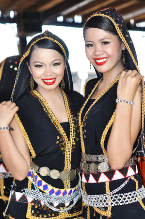 harvest festival: Kota Kinabalu, Sabah, Malaysia - MAY 30 2014: Smiling Kadazan Dusun from Borneo Tribe in traditional Kadazan Dusun costumes during the Sabah State Harvest Festival celebration or Kaamatan in local language in Kota Kinabalu. Editorial
