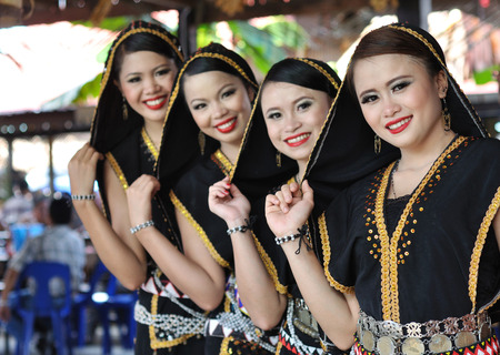 harvest festival: Kota Kinabalu, Sabah, Malaysia - MAY 30 2014: Kadazan Dusun Women from Borneo Tribe in traditional Kadazan Dusun costumes during the Sabah State Harvest Festival celebration.