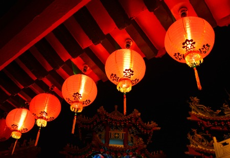 Red Lanterns glowing in the dark in Thean Hou Temple, Kuala Lumpur. Shoot during night time. Red lanterns is famous for decoration in Asian countries during Chinese Lunar New Year and Mid-Autumn Festival. Stock Photo