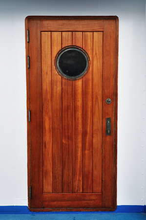 Wooden Porthole door in a shipcruise.