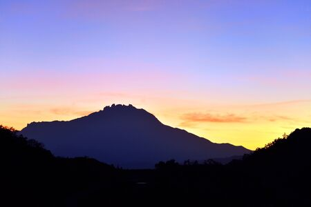 kinabalu: Silhouette of Mt. Kinabalu during colorful sunrise. Mt. Kinabalu is the highest mountain in Malaysia and one of major tourists attraction in Sabah Borneo.