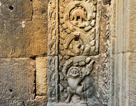 Bass relief of an animals carved in a stone wall in Ta Prohm Temple, Siem Cambodia. One of the famous carve is the dinosaur carving. photo