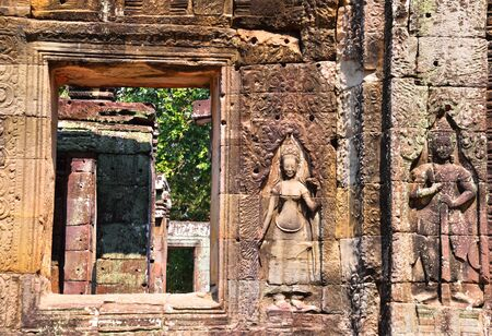 bass relief: Apsaras and bass relief wall carving in Banteay Kdei, Angkor Wat, Siem Reap, Cambodia. Stock Photo