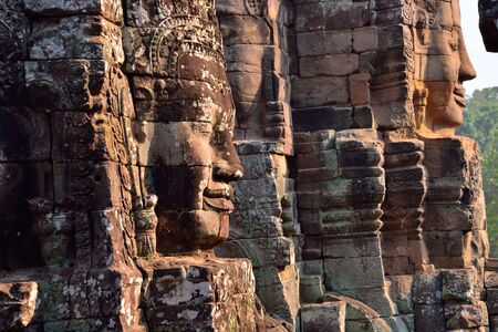 bass relief: Faces in ancient Bayon Temple located in Angkor Wat, Siem reap, Cambodia.