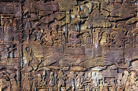 bass relief: Bass relief carving on a wall at Bayon Temple, Bayon Temple is located in Angkor wat temple complex, Siem Reap, Cambodia. Stock Photo