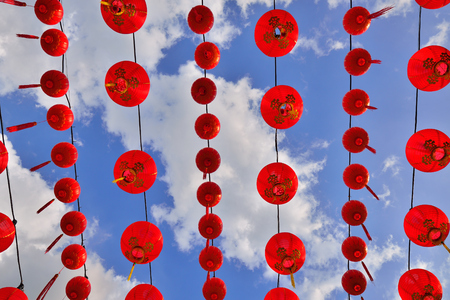 Red Chinese Paper Lanterns against a Blue Sky. photo