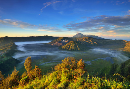 mountain climbing: Mount Bromo volcano during sunrise, the magnificent view of  Mt. Bromo located in Bromo Tengger Semeru National Park, East Java, Indonesia. Stock Photo