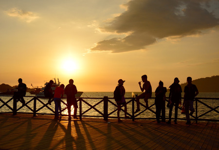 kota kinabalu: KOTA KINABALU MALAYSIA  MARCH 27 2015: Local people and tourist enjoying sunset at Kota Kinabalu waterfront.