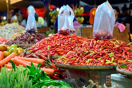 kinabalu: Vegetable stall selling red chilies carrots tomatoes and other type of vegetables in Kota Kinabalu night market Sabah Borneo Malaysia.