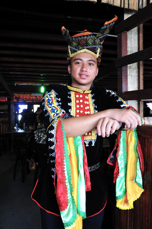 harvest festival: KOTA KINABALU MALAYSIA  MAY 30 2015: Portrait of young man of Kadazandusun ethnic in traditional costumes during the State Harvest Festival Celebration in KDCA Kota Kinabalu Sabah.