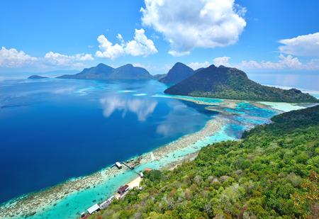 Aerial view of tropical island of Bohey Dulang near Sipadan Island Sabah Borneo Malaysia. 스톡 콘텐츠