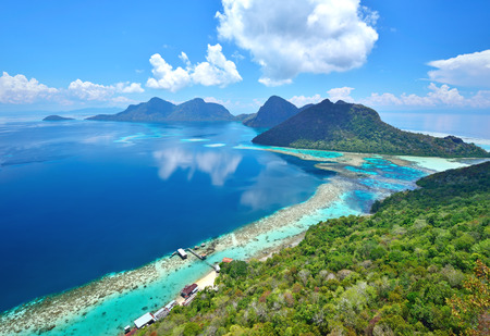 Aerial view of tropical island of Bohey Dulang near Sipadan Island Sabah Borneo Malaysia. Stock Photo