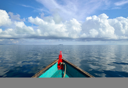 bow of boat: Wooden boat bow front view against cloudy blue sky on a tropical water in Sabah Borneo, Malaysia. Stock Photo