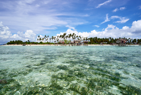 mabul: Tropical island from the distance with clear and transparent water Stock Photo