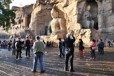 world cultural heritage: DATONGSHANXI CHINA  OCT 05: Visitors at Yungang Grottoes on Oct 05 2012 in Datong Shanxi China. Yungang Grottoes is World cultural heritage and major tourist attraction in China. Editorial