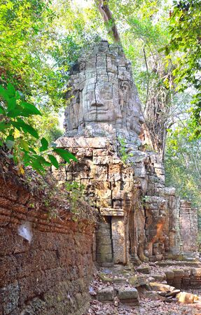 siem reap: Face of Buddha in Angkor Thom entrance, Siem Reap, Cambodia. Stock Photo