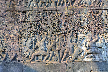 bas relief: Wall carving - bas relief in Bayon temple, Siem Reap, Cambodia. Stock Photo