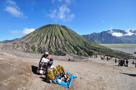 flower seller: EAST JAVA, INDONESIA - MAY 11: Unidentified flower seller at Mount Bromo national park on May 11, 2015. Mount Bromo is one of the most visited tourist attractions in East Java , Indonesia.