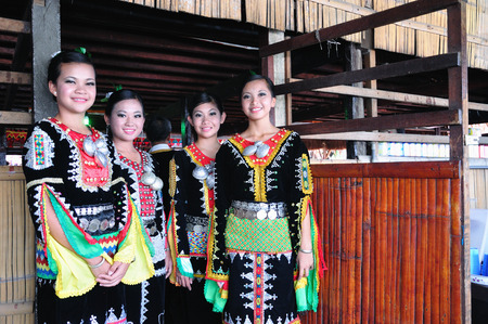 sabah: KOTA KINABALU, MALAYSIA - MAY 30, 2015: Young girls from Kadazandusun tribe in their traditional costume during the Sabah State Harvest festival celebration in Kota Kinabalu, Sabah Borneo, Malaysia.