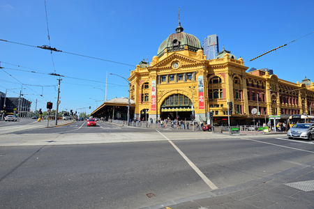 flinders: MELBOURNE, AUSTRALIA - OCTOBER 24: View of Flinders street station on October 24, 2015. Its the busiest station on Melbournes metropolitan network and one of the iconic landmark in Melbourne. Editorial