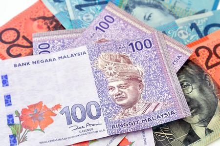 australian dollars: A close-up photograph of Australian dollars and Malaysias ringgit Malaysia currency. Stock Photo