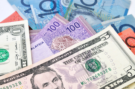A close-up photograph of Australian dollars, United State dollars and Malaysia's ringgit Malaysia currency.