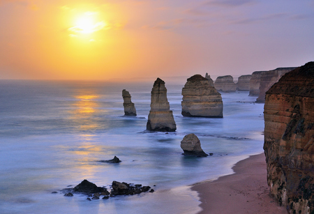 Moonset over Twelve Apostles in Victoria, Australia. Visible noise due to long exposure and high iso shoot during low light.