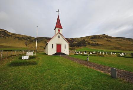 lutheran: Old red wooden Lutheran church near Vik beach, Reynisfjara, Iceland