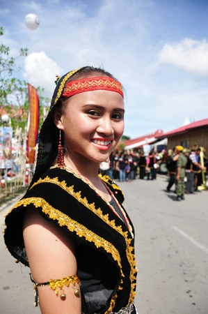 harvest festival: KOTA KINABALU, MALAYSIA - MAY 30, 2015: Lovely smiling girl in traditional costume during Harvest Festival, a natives festival from Sabah Borneo Malaysia.