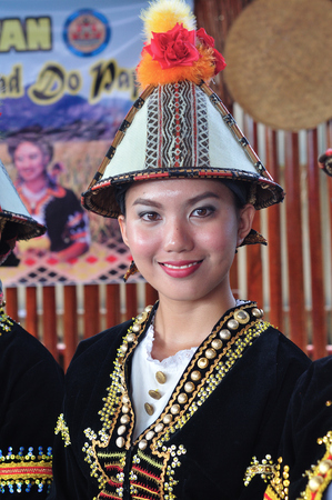 Lovely smiling girl in traditional costume during Harvest Festival, a natives festival from Sabah Borneo Malaysia.