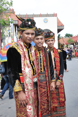harvest festival: KOTA KINABALU, MALAYSIA - MAY 30, 2015: Young men of Kadazandusun ethnic in traditional costumes during the State Harvest Festival in  Kota Kinabalu, Sabah Borneo