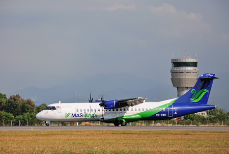 kota kinabalu: KOTA KINABALU, MALAYSIA - MARCH 10, 2016: MASwings airplane taxiing at Kota Kinabalu International Airport. MASwings is a regional airline operating the Rural Air Services RAS in East Malaysia.