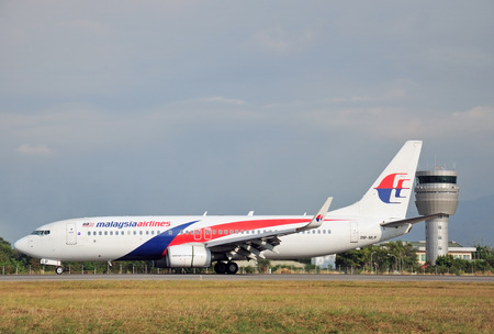kinabalu: KOTA KINABALU, MALAYSIA - MARCH 10, 2016: Malaysia Airlines Boeing 737-800 taxiing at Kota Kinabalu International Airport. Malaysia Airlines is the flag carrier airline of Malaysia.