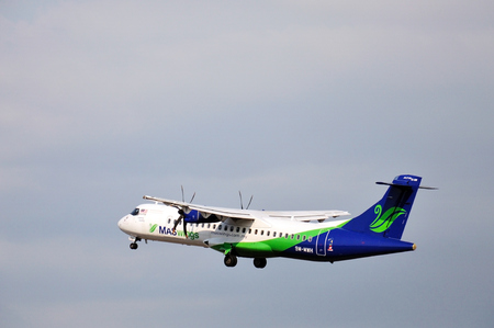 kota kinabalu: KOTA KINABALU, MALAYSIA - MARCH 10, 2016: MASwings airplane takes off at Kota Kinabalu International Airport. MASwings is a regional airline operating the Rural Air Services RAS in East Malaysia.
