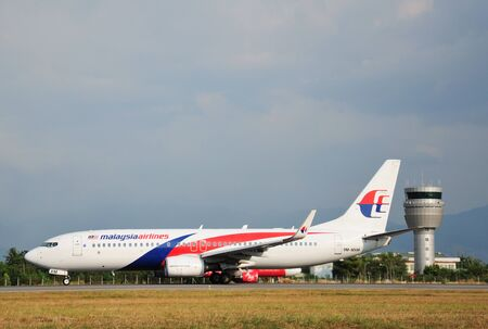 KOTA KINABALU, MALAYSIA - MARCH 10, 2016: Malaysia Airlines Boeing 737-800 taxiing at Kota Kinabalu International Airport. Malaysia Airlines is the flag carrier airline of Malaysia.