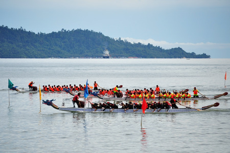 dragonboat: KOTA KINABALU, MALAYSIA - JUN 7, 2014 : Dragon Boat contestants racing to the finishing line during Sabah FCAS International Dragon Boat Race 2014 in Kota Kinabalu, Sabah, Malaysia.