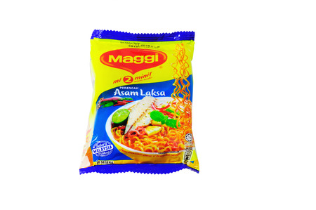 the instant noodles: KOTA KINABALU, MALAYSIA - MARCH 14, 2016: Maggi instant noodles. Owned by Nestle, Maggi is an international brand of soups, stocks, bouillon cubes, ketchup, sauces, seasonings and instant noodles. Editorial
