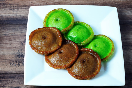 well made: Kuih Pinjaram on a plate. Kuih Pinjaram is a traditional kuih for the Bajau as well for the Bruneian Malay people in Brunei and in the states of Sabah in East Malaysia. Made from rice flour. Stock Photo