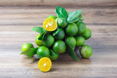 Bunch of Calamansi lime on a wooden table
